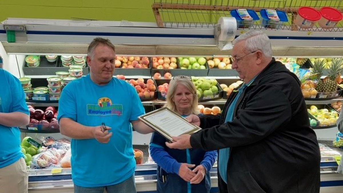 Scott City Mayor Norman Brant read the proclamation aloud and gave a plaque to the store,...