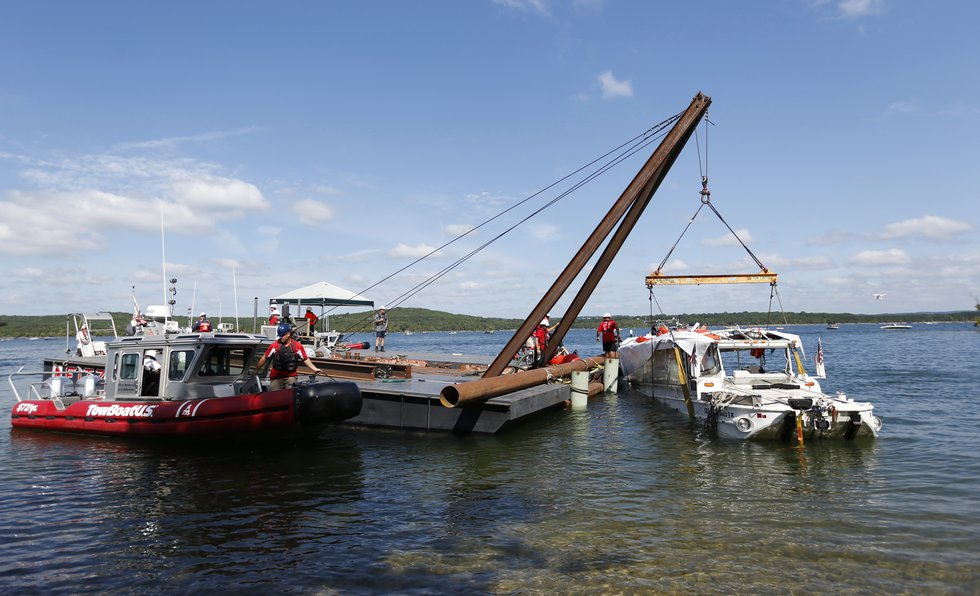 The duck boat that sank in Table Rock Lake in Branson, Mo., is raised Monday, July 23, 2018....