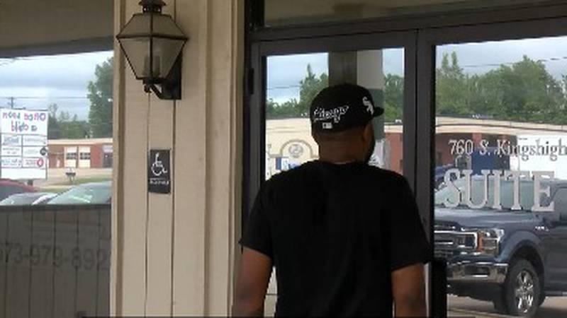 Job seeker walking into the job center looking for employement