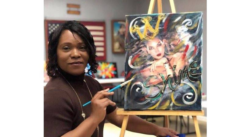 """Yvonne """"Renee"""" Neal poses for the camera as she works on a painting. (Source: Madelyn Bandermann)"""