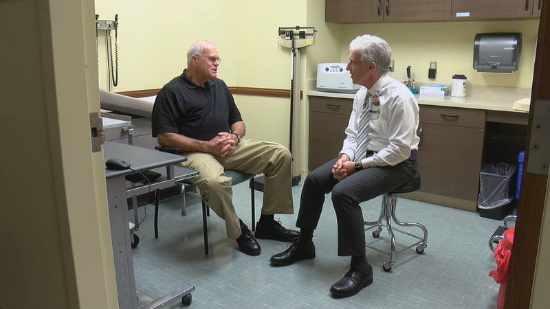 Dr. Paul Newhouse talks with patient Wes Suddarth. (Source: KFVS)