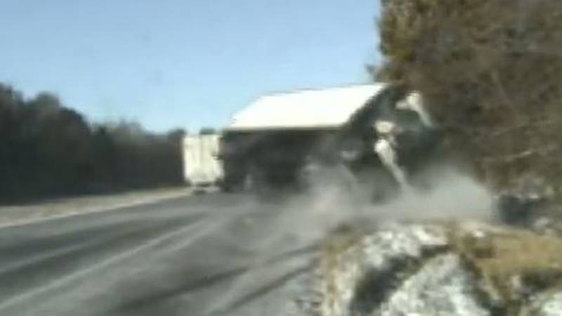 Box truck overturns in Wayne City, IL, narrowing missing two troopers and a woman with a flat...