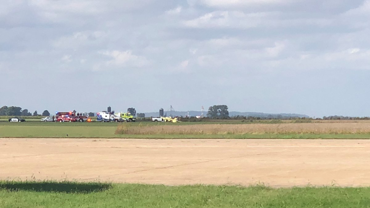 Emergency crews rush to the Cape Girardeau Regional Airport after a small yellow plane flipped...