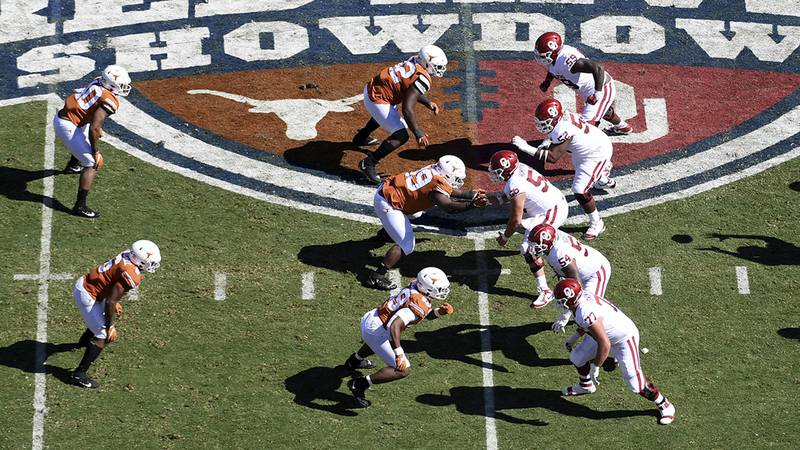 FILE - In this Oct. 12, 2019 file photo, Oklahoma, right, runs a play against Texas in the...