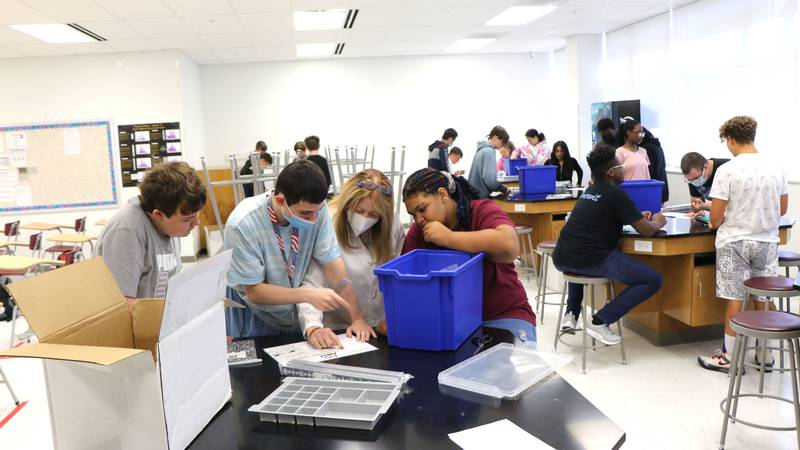 Students in Kathy Miller's robotics class at PBHS break off into groups on Wednesday, Sept. 8...