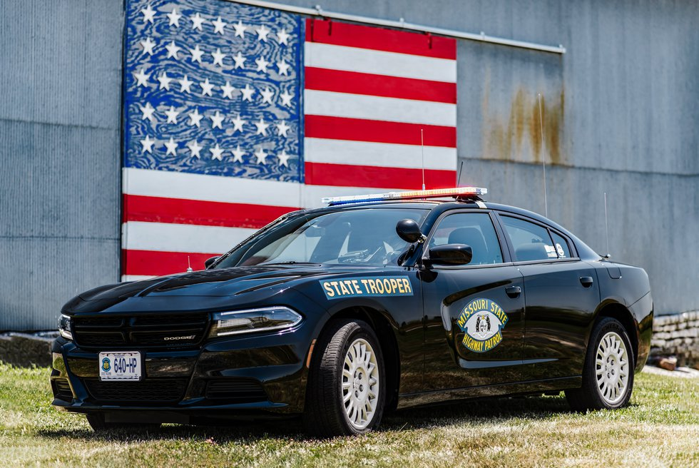 MSHP's 'Best Looking Cruiser' photo entry features Doge Charger parked in front of a rustic...