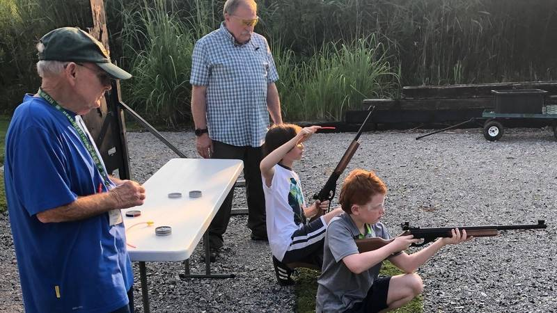Holden Sargent (front) and Jackson Gray (back) test out new air rifles thanks to a grant from...
