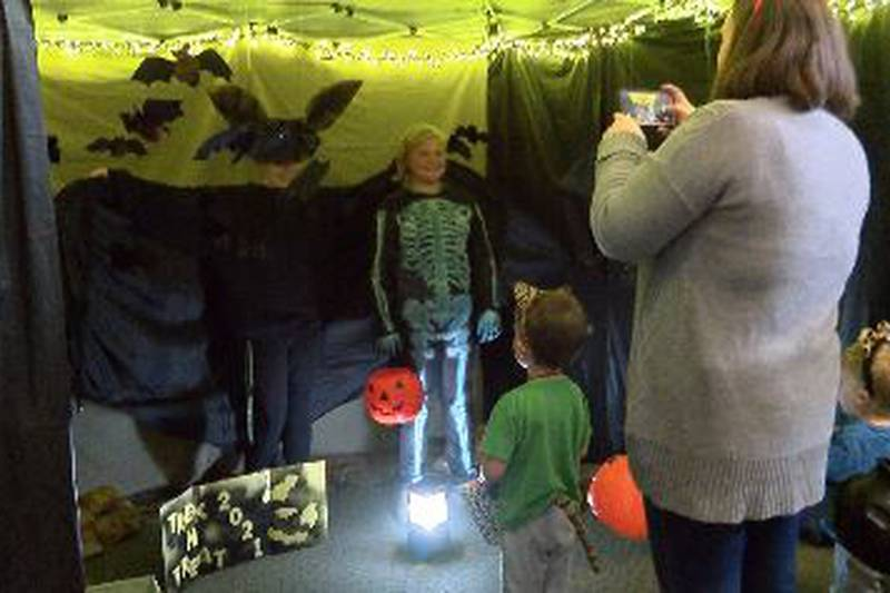 Kids and adults lined up to learn about the different animals at the Trek N' Treat event held...