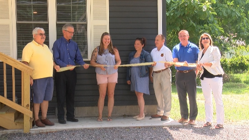Habitat for Humanity cuts the ribbon on the recent house they built in Herrin, Illinois.