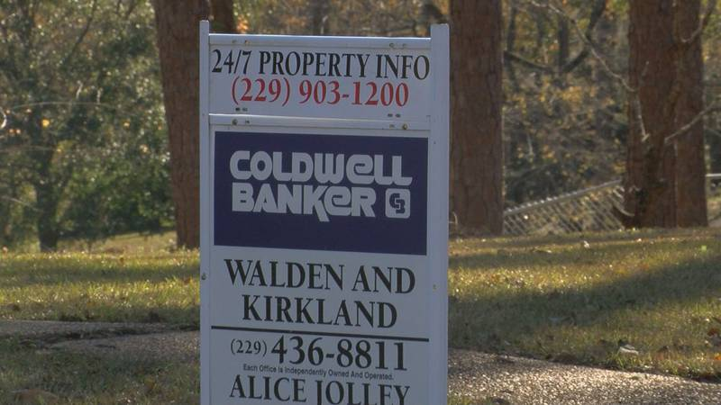 A for sale sign sits in a front yard in Lee County (Source: WALB)