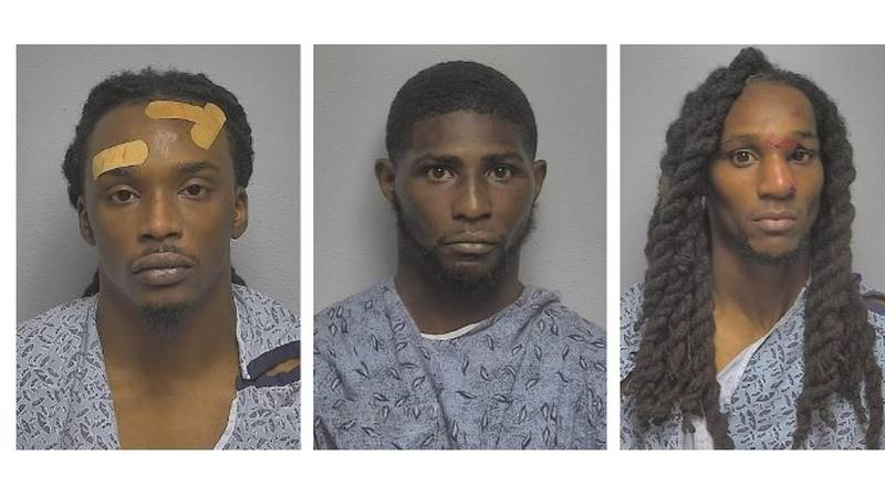 (Left to right) Edward Nuitall, Michael Wafford and Lyndell Wafford, all of Chicago, were...