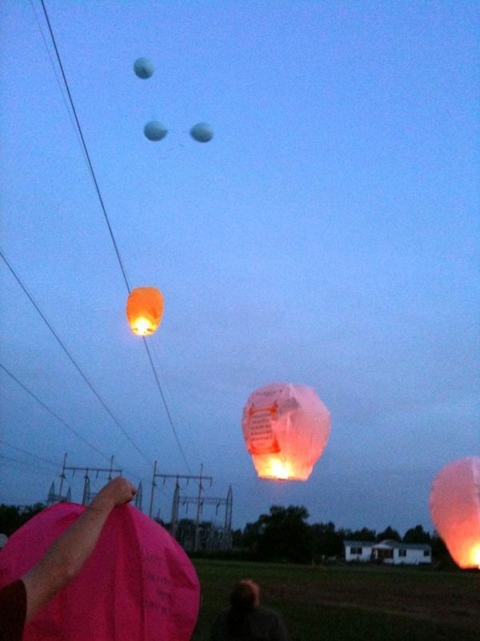 Deborah's family releases balloons and lanterns in her memory.