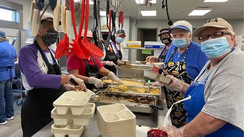 Volunteers prepare meals at Marcella's Kitchen in Marshall County. The demand for food services...