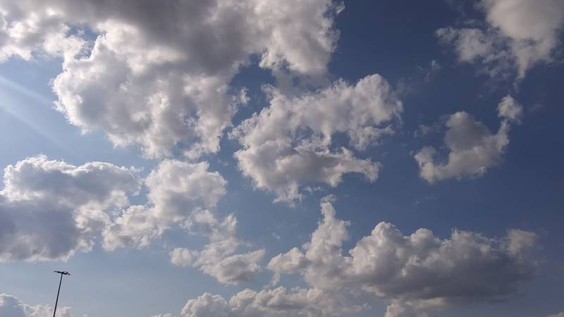 Light fluffy clouds dot the sunny sky in Humboldt, Tennessee.