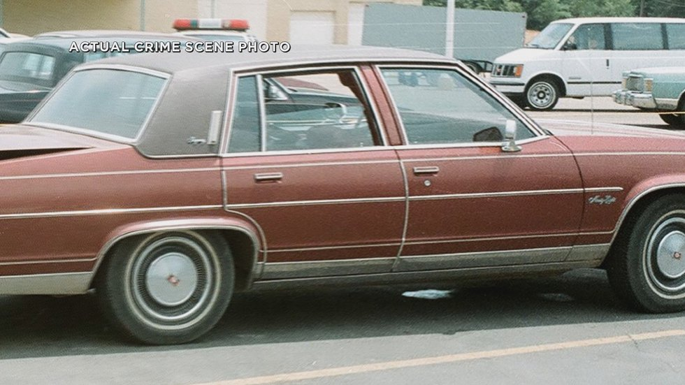 Crime scene photo of Rowland's car left in a Poplar Bluff shopping center with his body in the...