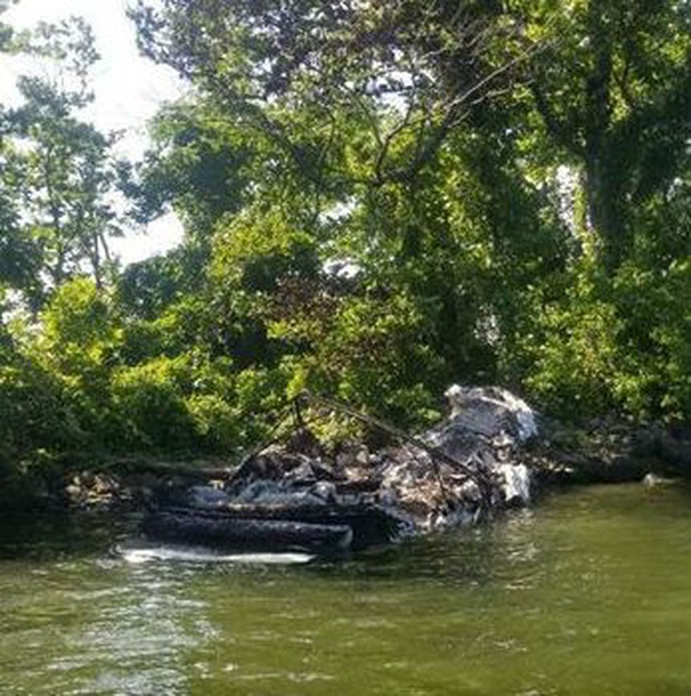 The boat's wreckage the morning after the fire. (Source: Brandon Mayberry)