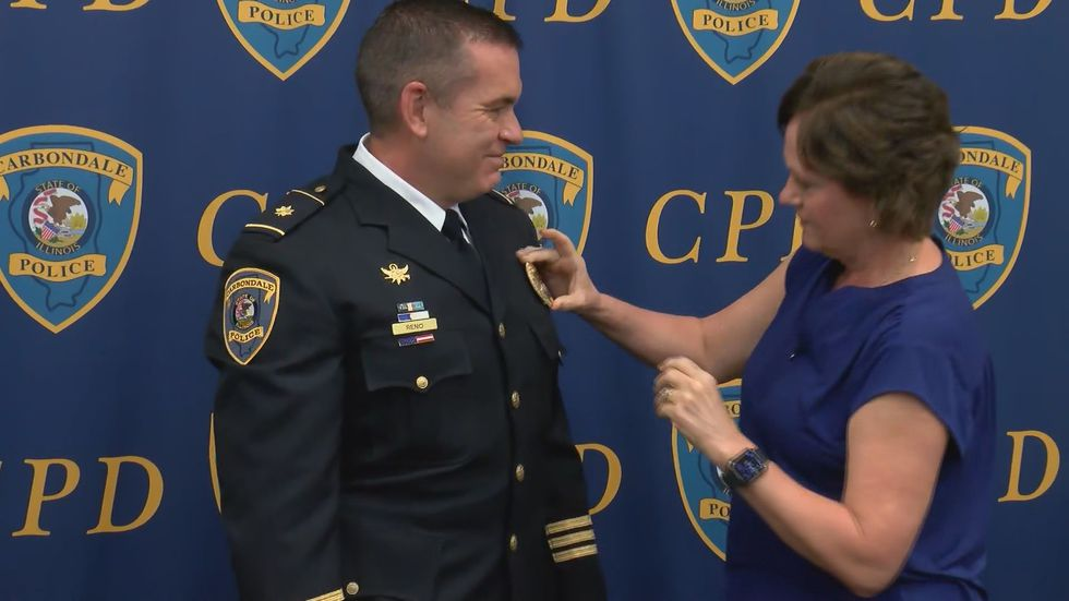After Stan Reno was named Chief of Police for Carbondale, his wife, Heather Reno, pinned the...