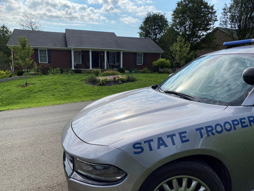 FBI and IRS agents were at Brooks Houck's home on Thursday along with Kentucky State Police...