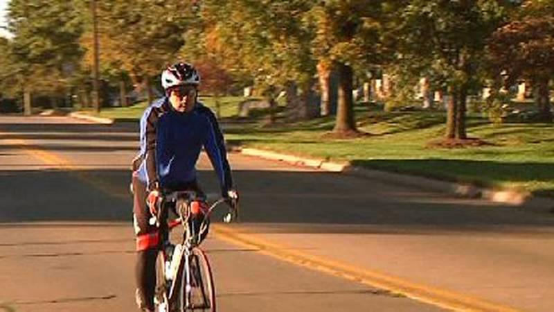 A person is riding a bicycle as part of a previous Tour de Cape Girardeau event.