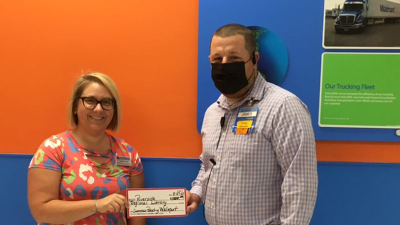 James Russell, store manager for Walmart in Jackson, presented Alynda Smithey, Riverside...