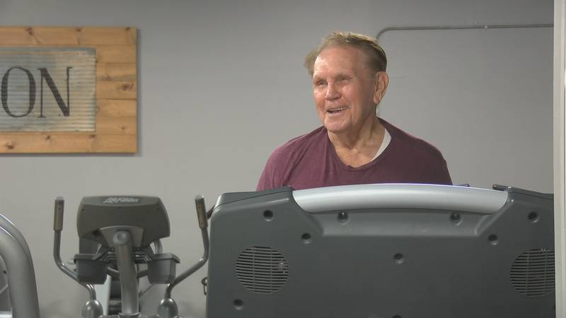 Harlond Womack, 95, sings a country tune as he walks on the treadmill at Fitness Connection in...