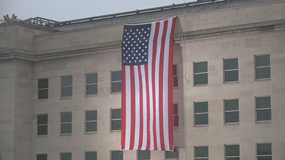 A flag draped over the side of the Pentagon.