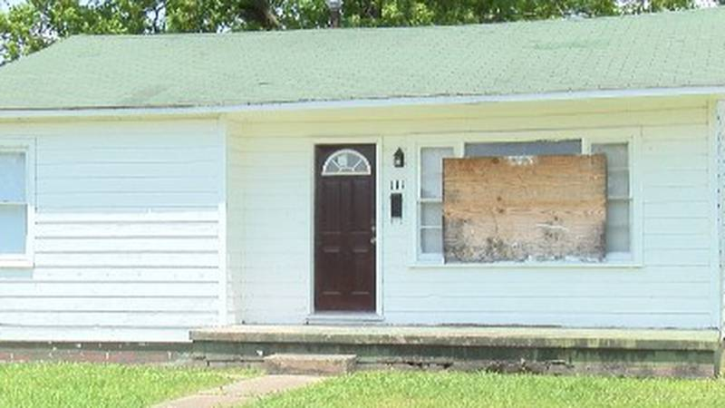 A boards on the windows of a  house near downtown Poplar Bluff to fend off would be criminals.