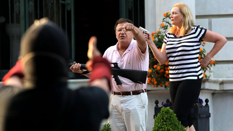 FILE - In this June 28, 2020 file photo, armed homeowners Mark and Patricia McCloskey, standing...
