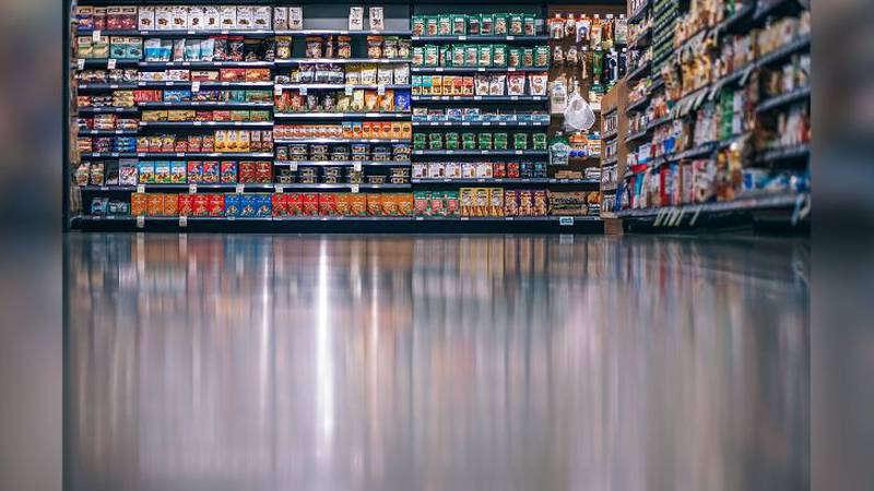 The picture shows shelves of food in a grocery store.