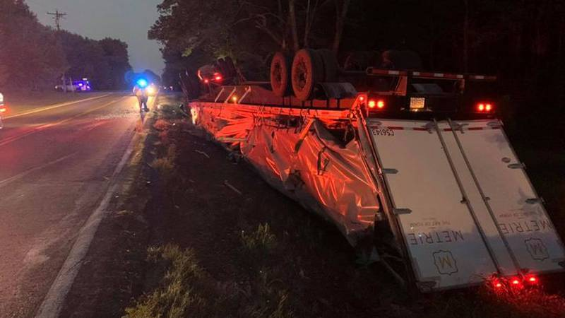 Crews spent several hours on Sunday and Monday, September 27 removing an overturned log truck...