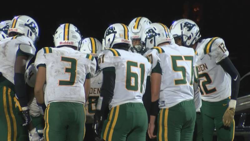 The Malden Green Wave huddle up before their next play against Hayti on Friday night, October 15.