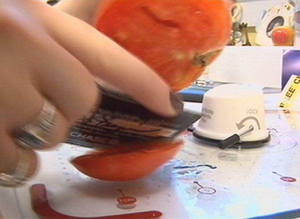 We swipe the credit card through the sharpener and then the tomato. It easily glides through now!