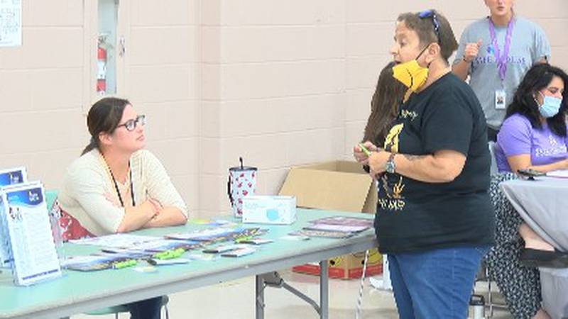Community members visit the Project Hope event at the Osage Centre.