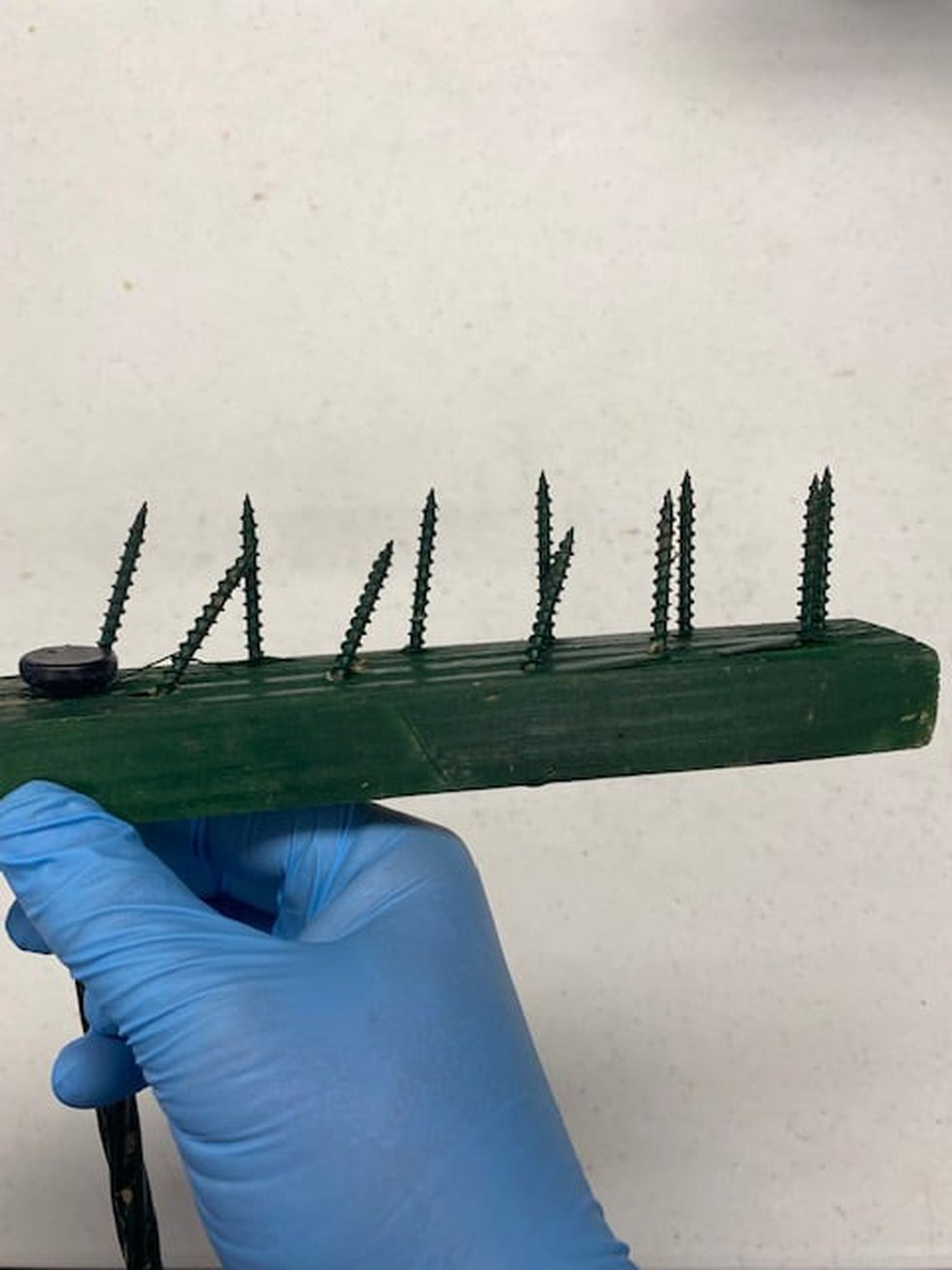 Police say homemade spiked boards have been found at least three times on different...