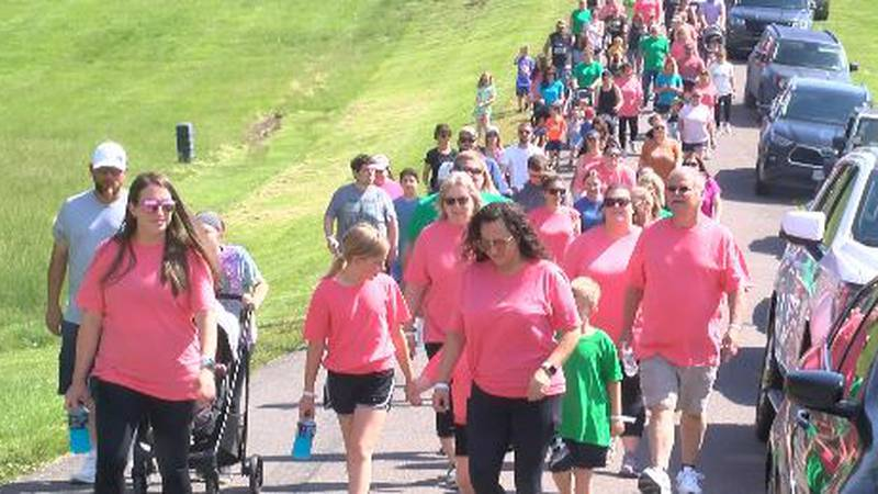 Hundreds walk around the loop at the Cape Girardeau County Park for infertility awareness.
