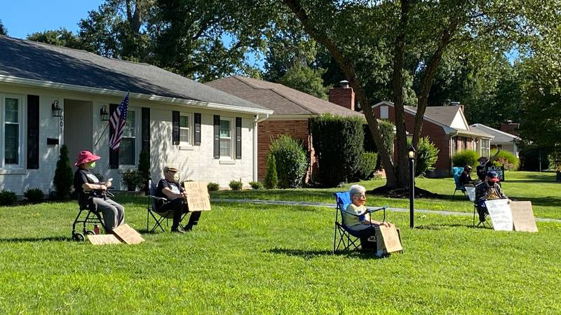Senior citizens gathered for a silent protest at the Kentucky Attorney General's home.
