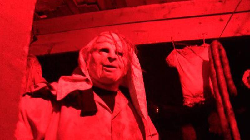 A volunteer is ready to scare the daylights out of visitors to the Haunted Hall of Horror.