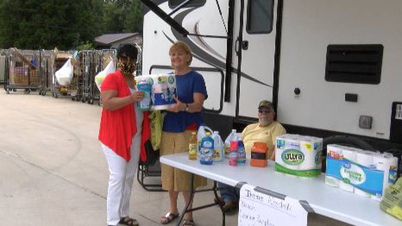 A woman donates items in Olive Branch to the family of a Hurricane Ida victim.