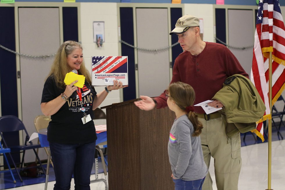 The Wallace family donates a new American flag to O'Neal Elementary School. (Source: Poplar...