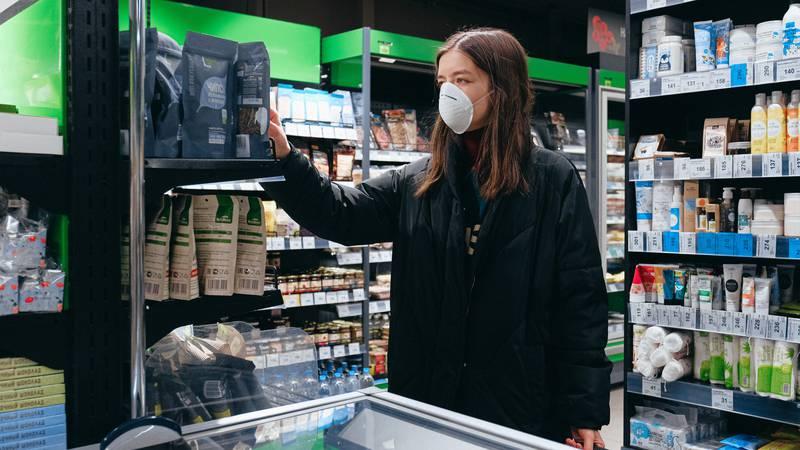 A woman shops wearing a facial mask during the coronavirus outbreak.