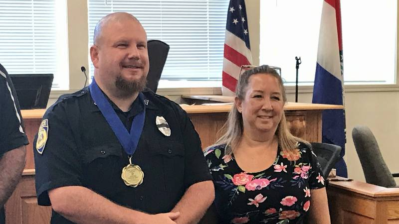 Officer Nathan Vails was awarded on Monday, September 30 for saving Cynthia Buatte from a fire...