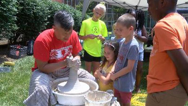A man makes pottery at the River Campus Summer Arts Festival in Cape Girardeau on Saturday.
