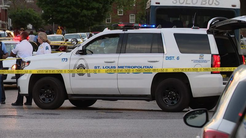 Police respond to a shooting in St. Louis on Monday. Authorities said three people died in the...