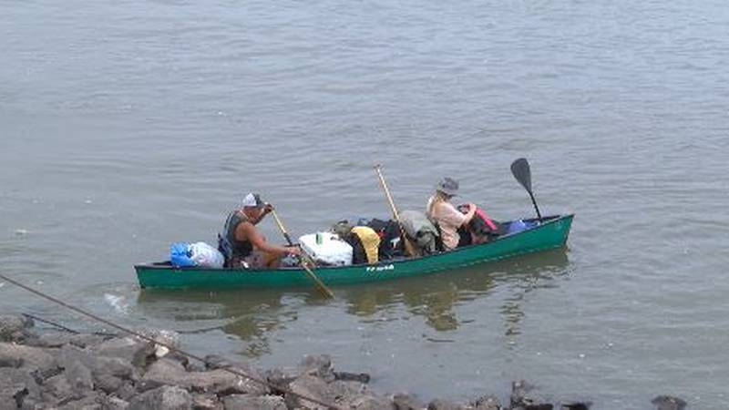 Caleb Korder and his girlfriend paddle their canoe down the Mississippi River.