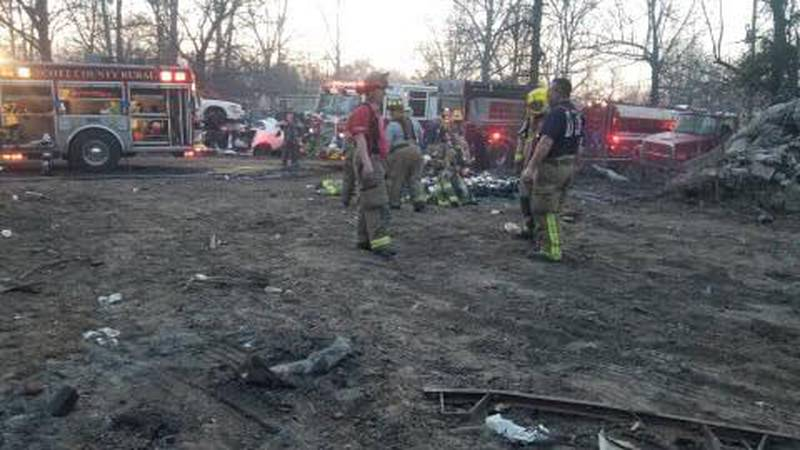Multiple departments battled a fire involving 100 vehicles and 10 acres of a heavily wooded...